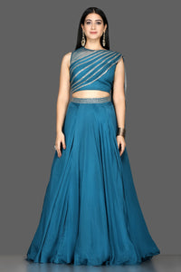 Buy blue embroidered silk lehenga online in USA with draped dupatta. Flaunt your extraordinary fashion sense with stunning Indian dresses, designer lehenga from Pure Elegance Indian fashion store in USA.-full view