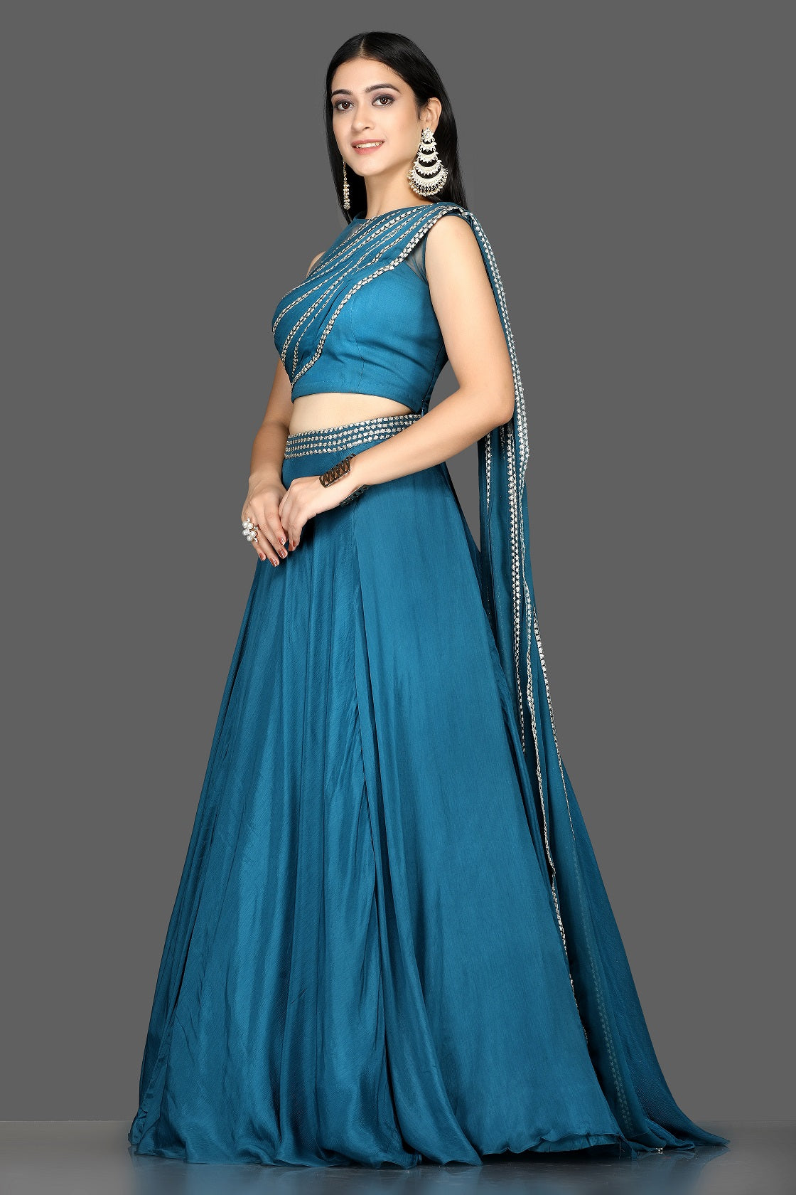 Buy blue embroidered silk lehenga online in USA with draped dupatta. Flaunt your extraordinary fashion sense with stunning Indian dresses, designer lehenga from Pure Elegance Indian fashion store in USA.-side