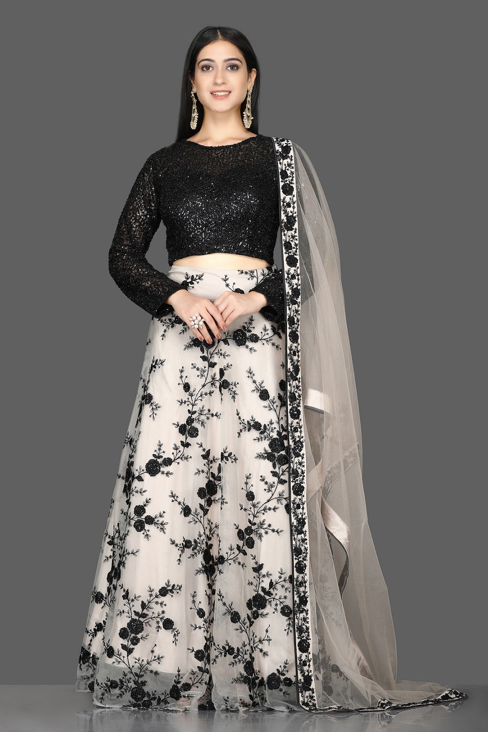 Shop stunning black sequin blouse with embroidered net skirt online in USA and dupatta. Flaunt your extraordinary fashion sense with stunning Indian dresses, designer lehenga from Pure Elegance Indian fashion store in USA.-full view