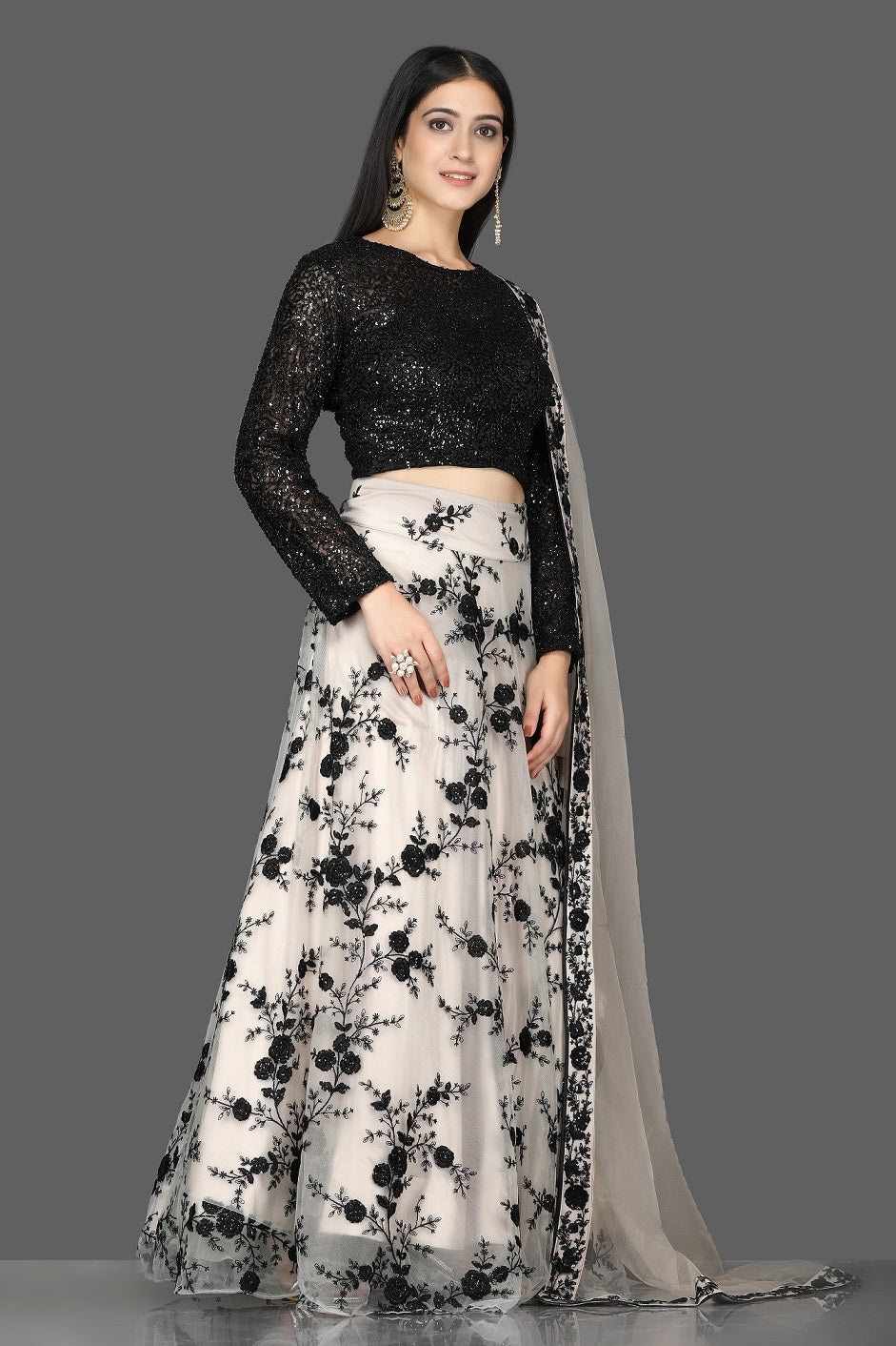 Shop stunning black sequin blouse with embroidered net skirt online in USA and dupatta. Flaunt your extraordinary fashion sense with stunning Indian dresses, designer lehenga from Pure Elegance Indian fashion store in USA.-side