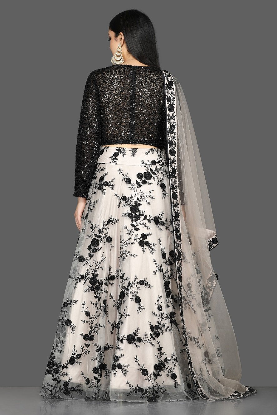 Shop stunning black sequin blouse with embroidered net skirt online in USA and dupatta. Flaunt your extraordinary fashion sense with stunning Indian dresses, designer lehenga from Pure Elegance Indian fashion store in USA.-back