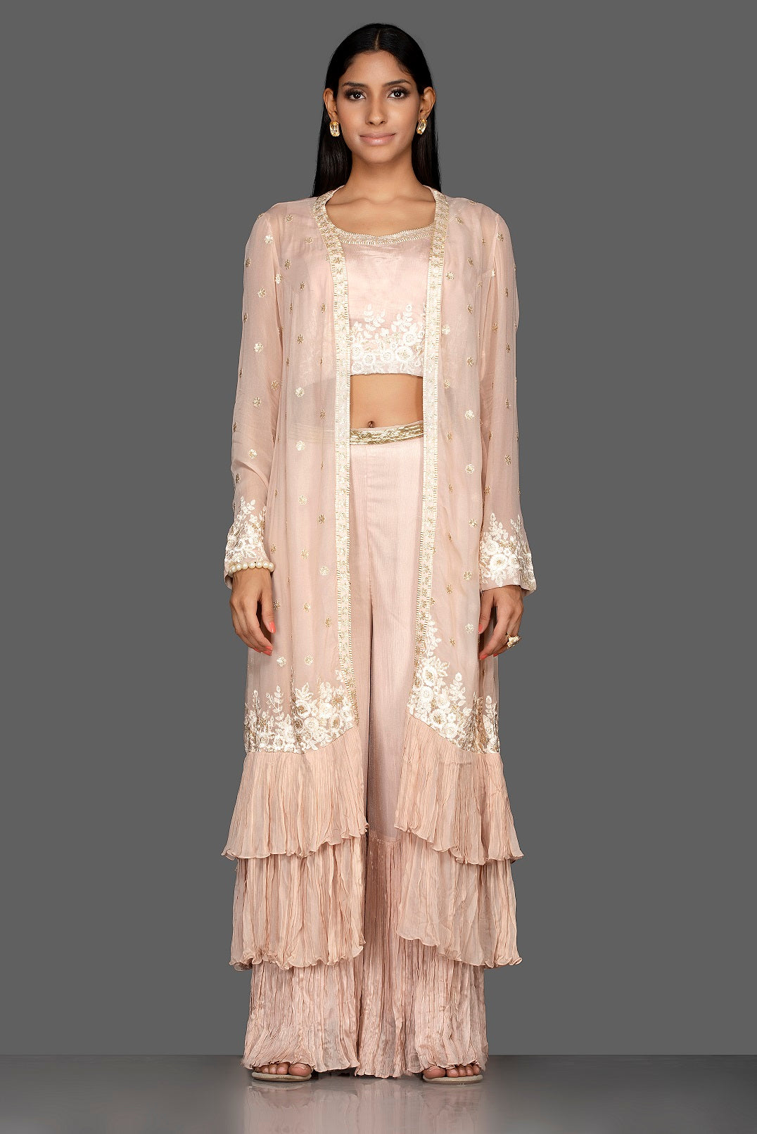 Buy alluring cream embroidered georgette crop top and palazzo online in USA with long shrug. Flaunt your extraordinary fashion sense with stunning Indowestern dresses, designer Anarkali suits from Pure Elegance Indian fashion store in USA.-full view