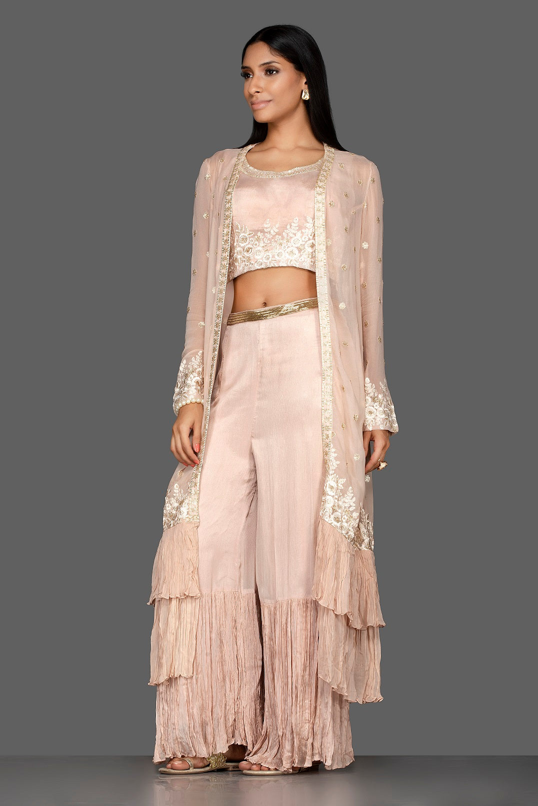 Buy alluring cream embroidered georgette crop top and palazzo online in USA with long shrug. Flaunt your extraordinary fashion sense with stunning Indowestern dresses, designer Anarkali suits from Pure Elegance Indian fashion store in USA.-side