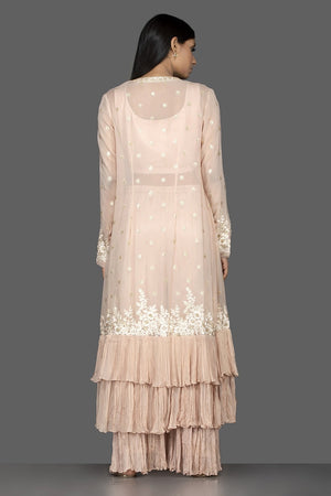 Buy alluring cream embroidered georgette crop top and palazzo online in USA with long shrug. Flaunt your extraordinary fashion sense with stunning Indowestern dresses, designer Anarkali suits from Pure Elegance Indian fashion store in USA.-back
