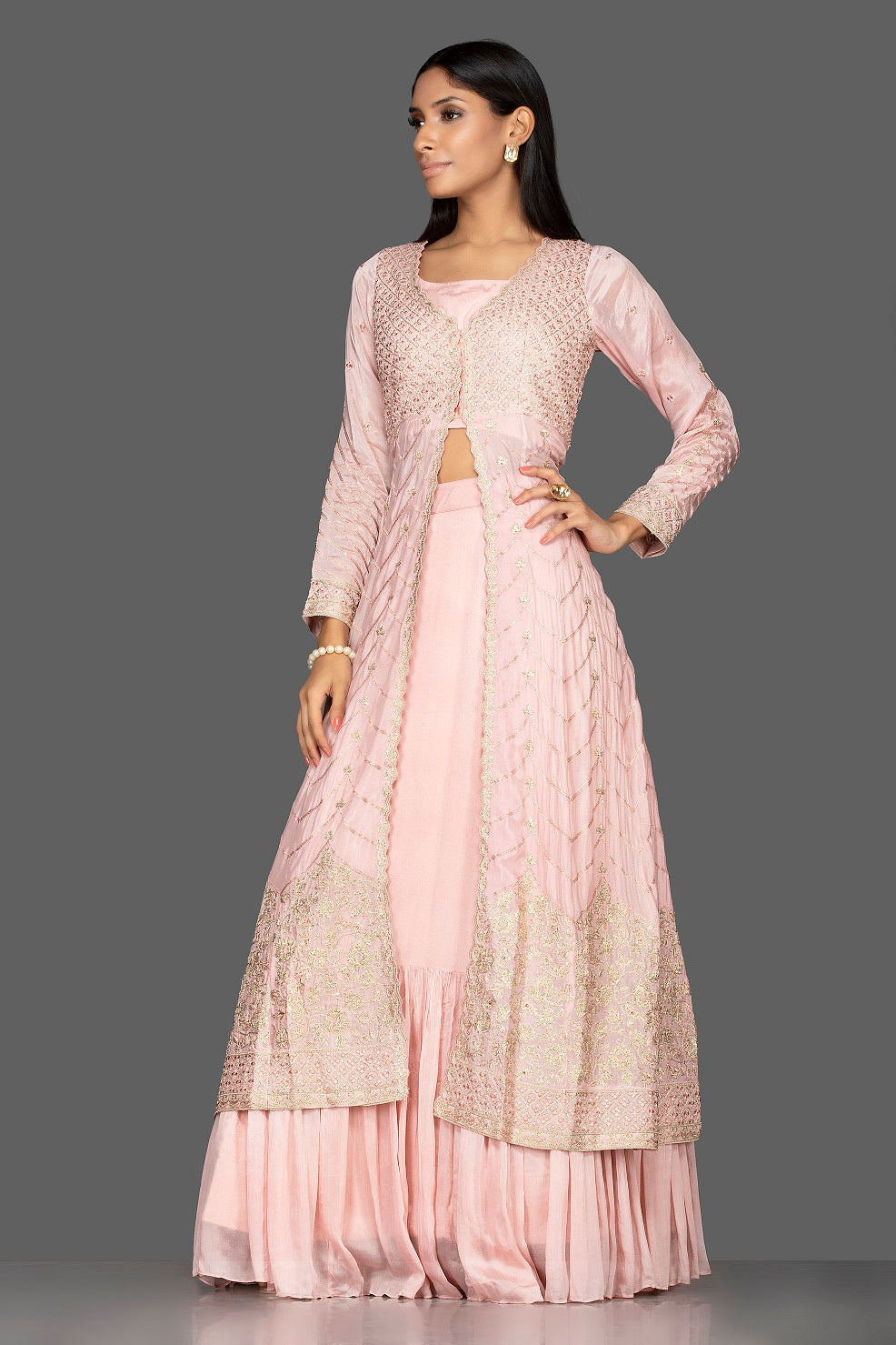 Buy powder pink top and skirt online in USA with embroidered long jacket. Flaunt your extraordinary fashion sense with stunning Indowestern dresses, designer Anarkali suits from Pure Elegance Indian fashion store in USA.-side