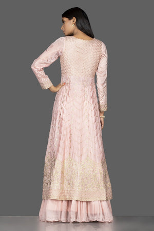 Buy powder pink top and skirt online in USA with embroidered long jacket. Flaunt your extraordinary fashion sense with stunning Indowestern dresses, designer Anarkali suits from Pure Elegance Indian fashion store in USA.-back