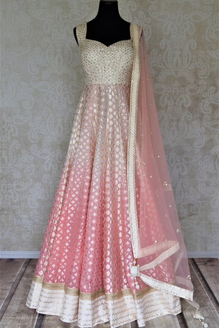 Buy beautiful ombre pink embroidered silk floorlength Anarkali suit online in USA with lace work. Dazzle at weddings and festive occasions with stunning designer Anarkalis from Pure Elegance Indian fashion store in USA.-full view