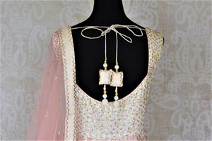 Buy beautiful ombre pink embroidered silk floorlength Anarkali suit online in USA with lace work. Dazzle at weddings and festive occasions with stunning designer Anarkalis from Pure Elegance Indian fashion store in USA.-back