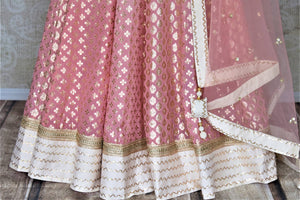 Buy beautiful ombre pink embroidered silk floorlength Anarkali suit online in USA with lace work. Dazzle at weddings and festive occasions with stunning designer Anarkalis from Pure Elegance Indian fashion store in USA.-bottom