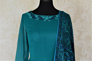 Shop gorgeous sea green embroidered georgette Anarkali online in USA with dupatta. Dazzle at weddings and festive occasions with stunning designer sharara and Anarkali suits from Pure Elegance Indian fashion store in USA.-top