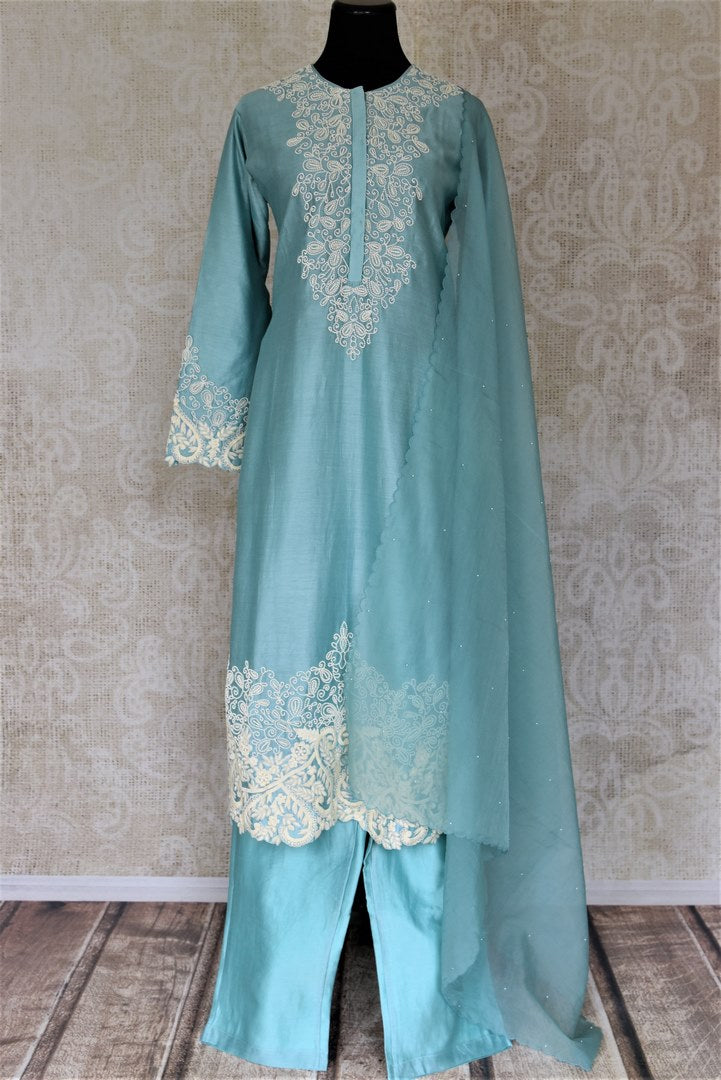 Buy alluring light blue pearl embroidery silk suit with palazzo online in USA and dupatta. Dazzle at weddings and festive occasions with stunning designer sharara and Anarkali suits from Pure Elegance Indian fashion store in USA.-full view