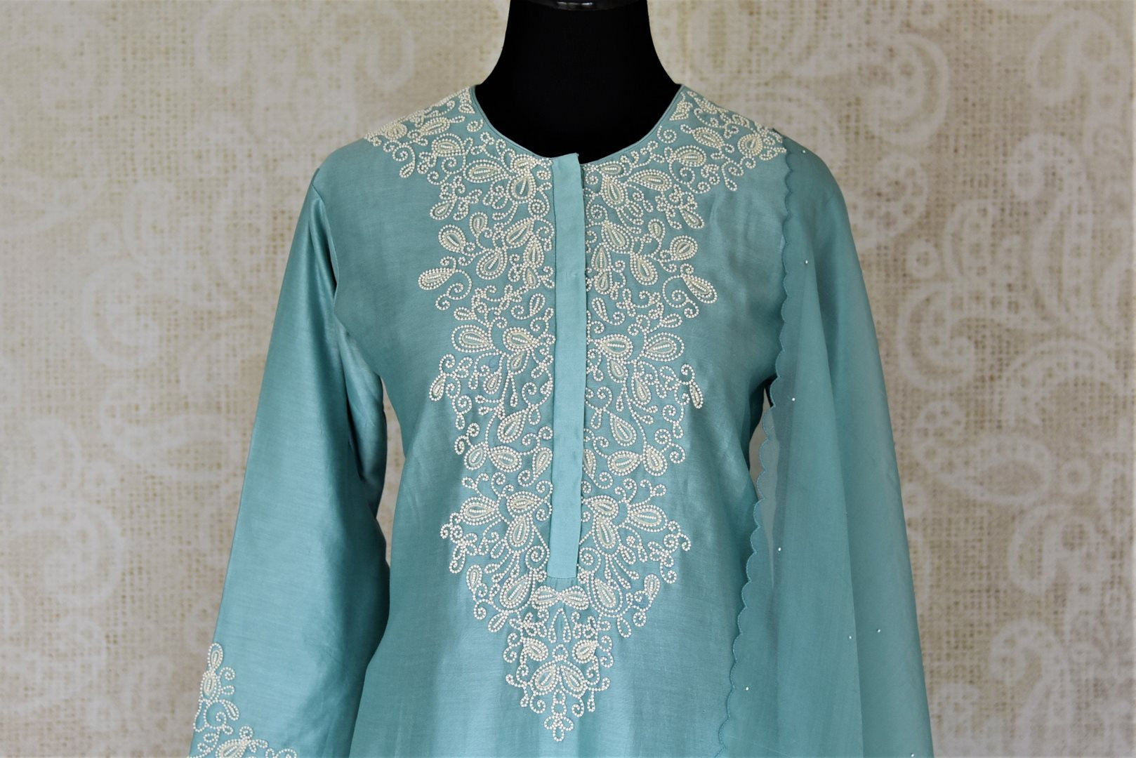 Buy alluring light blue pearl embroidery silk suit with palazzo online in USA and dupatta. Dazzle at weddings and festive occasions with stunning designer sharara and Anarkali suits from Pure Elegance Indian fashion store in USA.-front