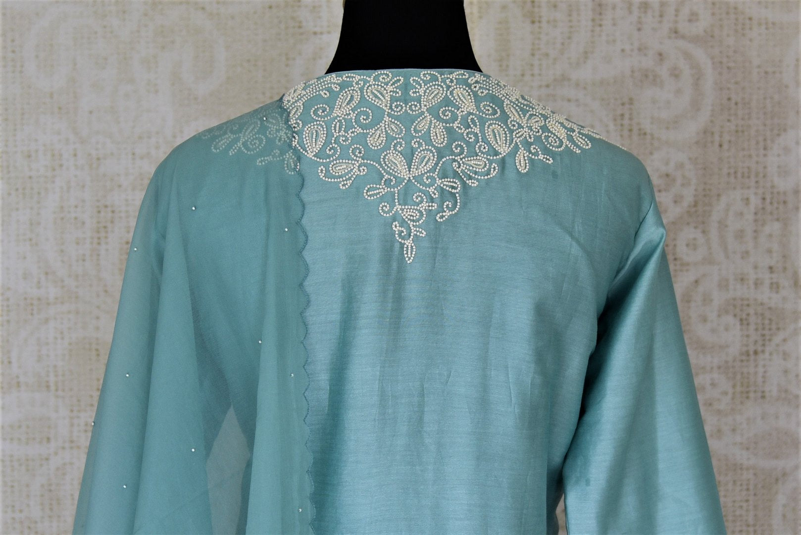 Buy alluring light blue pearl embroidery silk suit with palazzo online in USA and dupatta. Dazzle at weddings and festive occasions with stunning designer sharara and Anarkali suits from Pure Elegance Indian fashion store in USA.-back