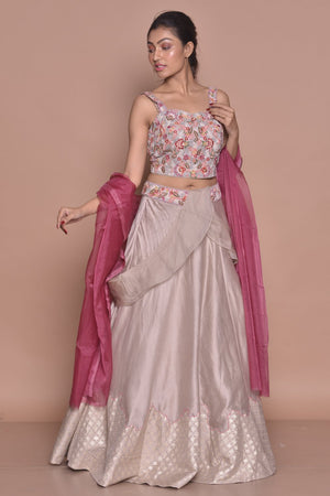 Shop light grey embroidered lehenga with online in USA and pink dupatta. Flaunt Indian fashion with exquisite designer suits, Anarkali suits, sharara suits from Pure Elegance Indian cloth store in USA. -front