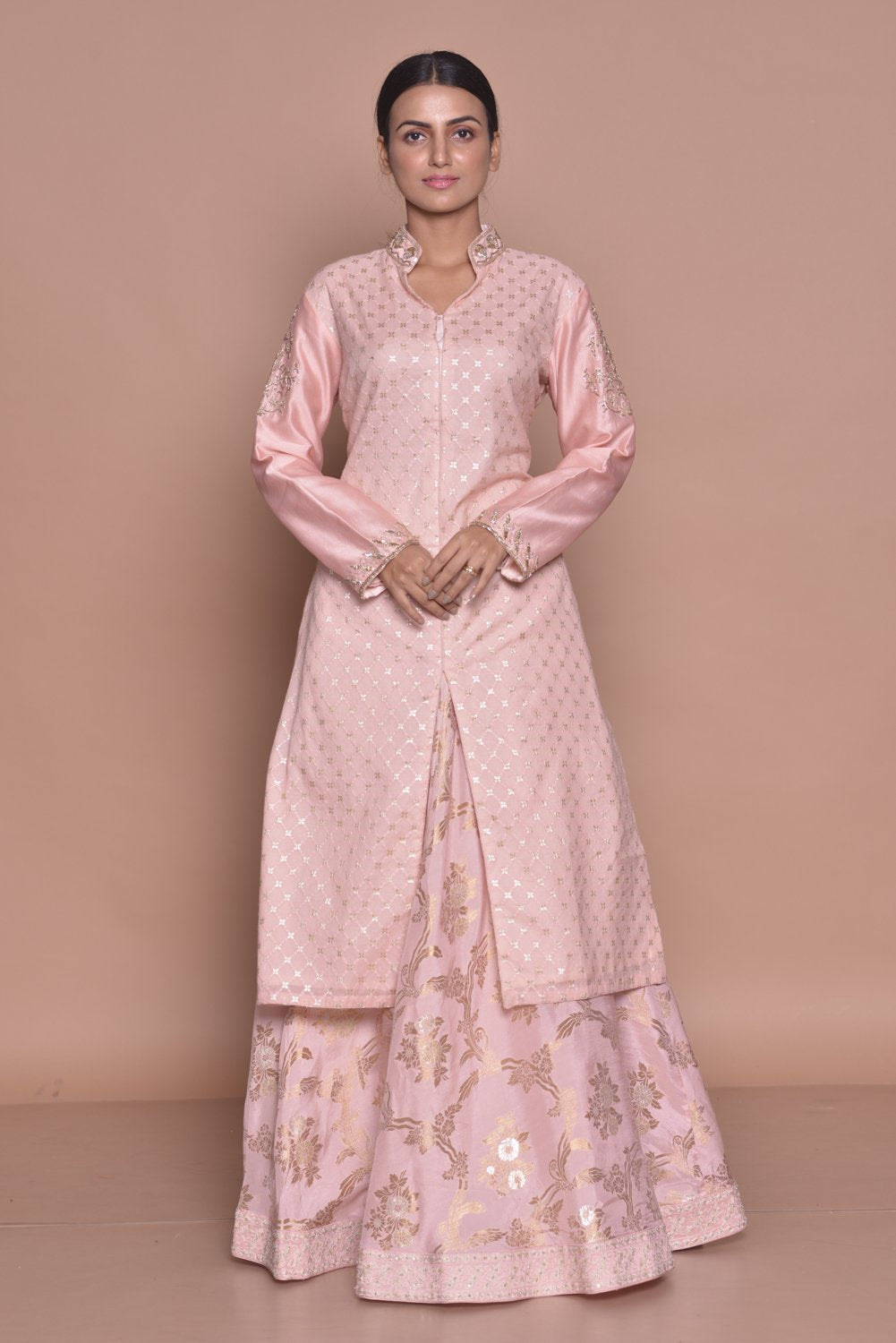 Buy elegant powder pink embroidered kurta with skirt with online in USA. Flaunt Indian fashion with exquisite designer suits, Anarkali suits, sharara suits from Pure Elegance Indian cloth store in USA. -front