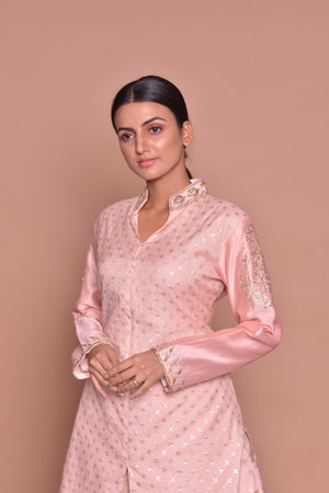 Buy elegant powder pink embroidered kurta with skirt with online in USA. Flaunt Indian fashion with exquisite designer suits, Anarkali suits, sharara suits from Pure Elegance Indian cloth store in USA. -closeup