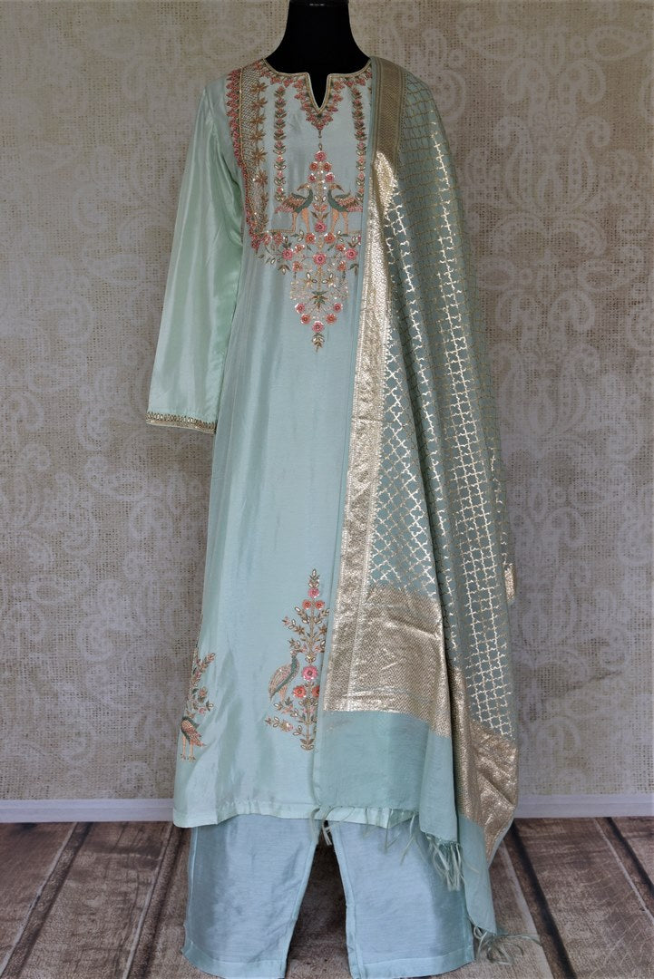 Shop exquisite mint green hand embroidery silk suit with palazzo online in USA and dupatta. Dazzle at weddings and festive occasions with stunning designer sharara and Anarkali suits from Pure Elegance Indian fashion store in USA.-full view