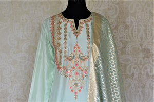Shop exquisite mint green hand embroidery silk suit with palazzo online in USA and dupatta. Dazzle at weddings and festive occasions with stunning designer sharara and Anarkali suits from Pure Elegance Indian fashion store in USA.-front