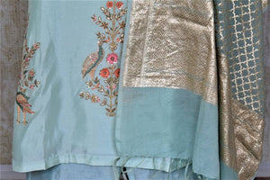 Shop exquisite mint green hand embroidery silk suit with palazzo online in USA and dupatta. Dazzle at weddings and festive occasions with stunning designer sharara and Anarkali suits from Pure Elegance Indian fashion store in USA.-bottom