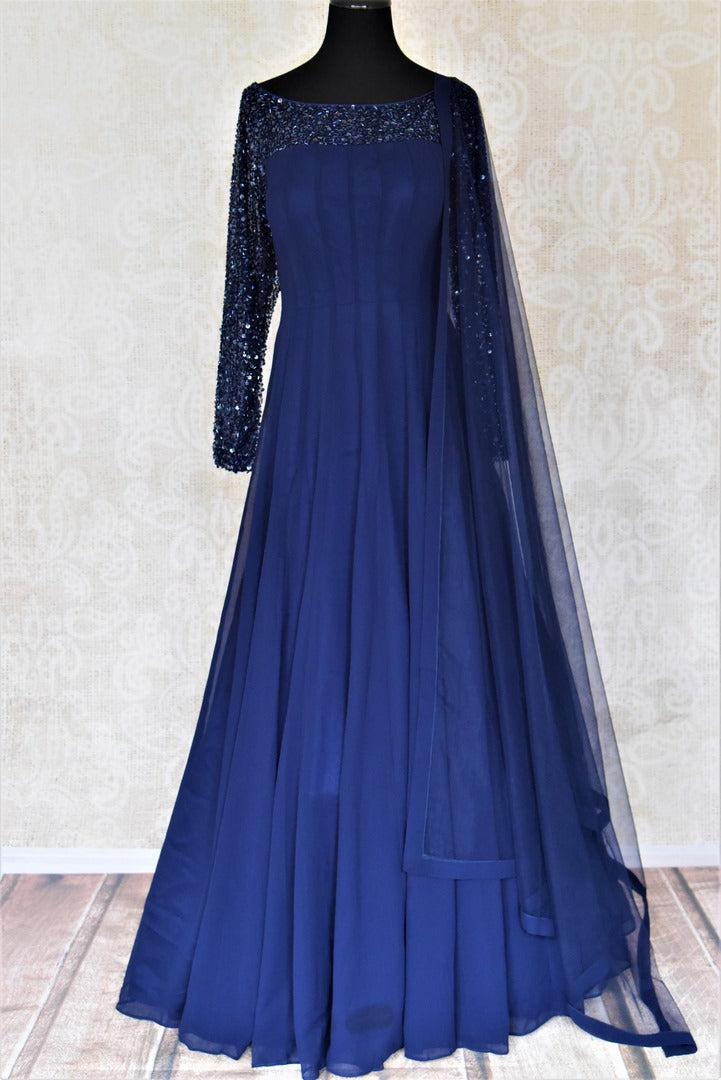Shop contemporary dark blue hand embroidered georgette boat-neck Anarkali online in USA with dupatta. Dazzle at weddings and festive occasions with stunning designer sharara and Anarkali suits from Pure Elegance Indian fashion store in USA.-full view
