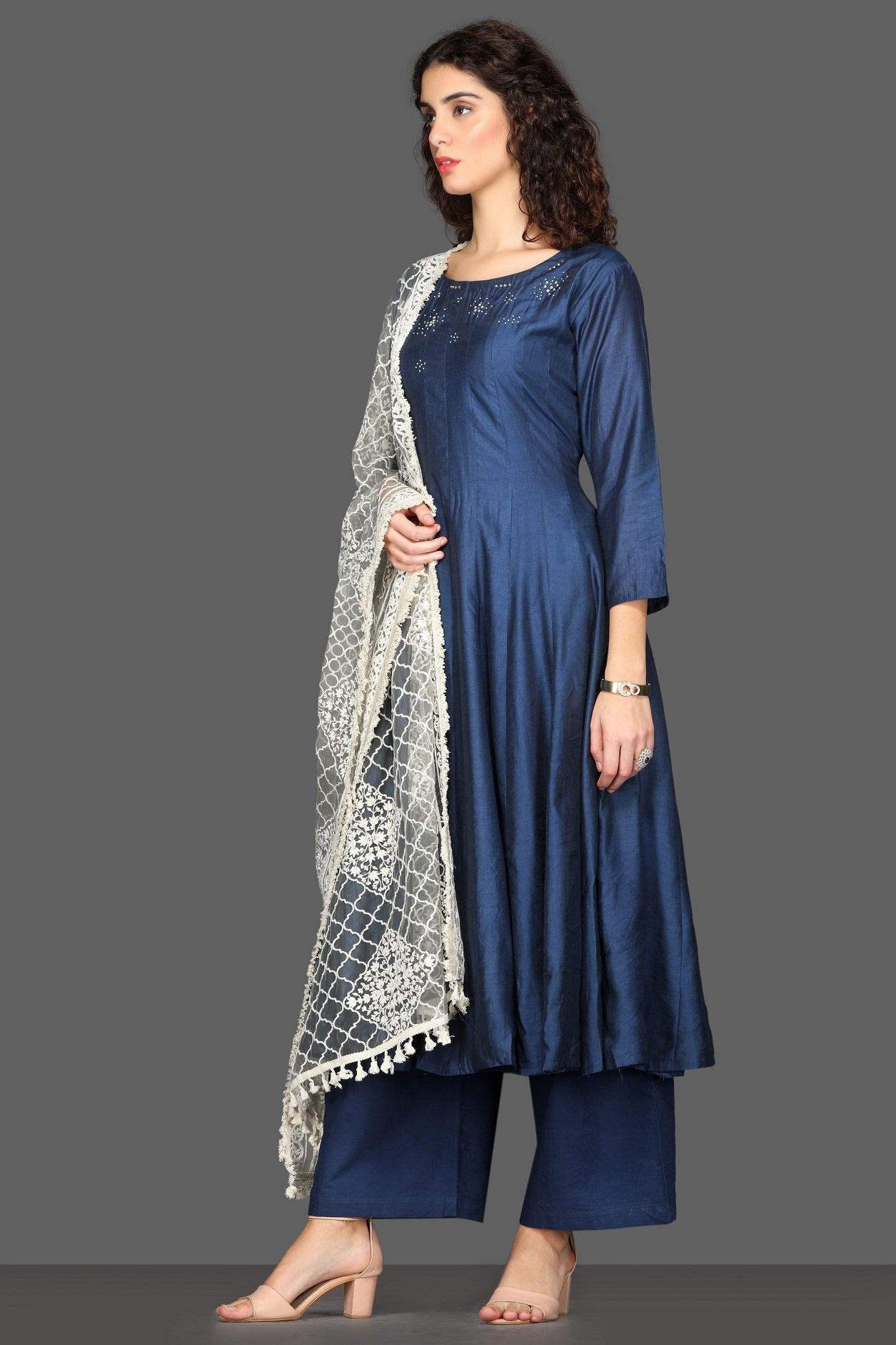 Buy elegant navy flared palazzo suit online in USA with white dupatta. Dazzle on weddings and special occasions with exquisite Indian designer dresses, sharara suits, Anarkali suits from Pure Elegance Indian fashion store in USA.-side