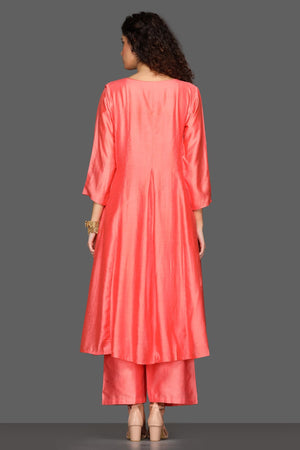 Shop gorgeous peach flared palazzo suit online in USA with embellished dupatta. Dazzle on weddings and special occasions with exquisite Indian designer dresses, sharara suits, Anarkali suits from Pure Elegance Indian fashion store in USA.-back