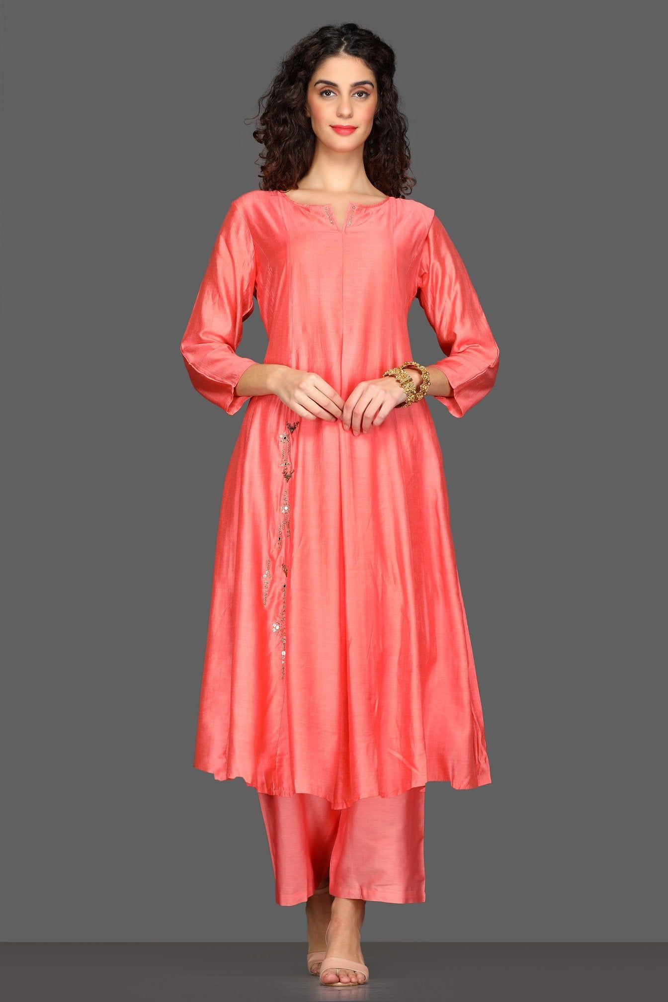 Shop gorgeous peach flared palazzo suit online in USA with embellished dupatta. Dazzle on weddings and special occasions with exquisite Indian designer dresses, sharara suits, Anarkali suits from Pure Elegance Indian fashion store in USA.-front