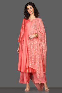 Shop gorgeous peach flared palazzo suit online in USA with embellished dupatta. Dazzle on weddings and special occasions with exquisite Indian designer dresses, sharara suits, Anarkali suits from Pure Elegance Indian fashion store in USA.-full view