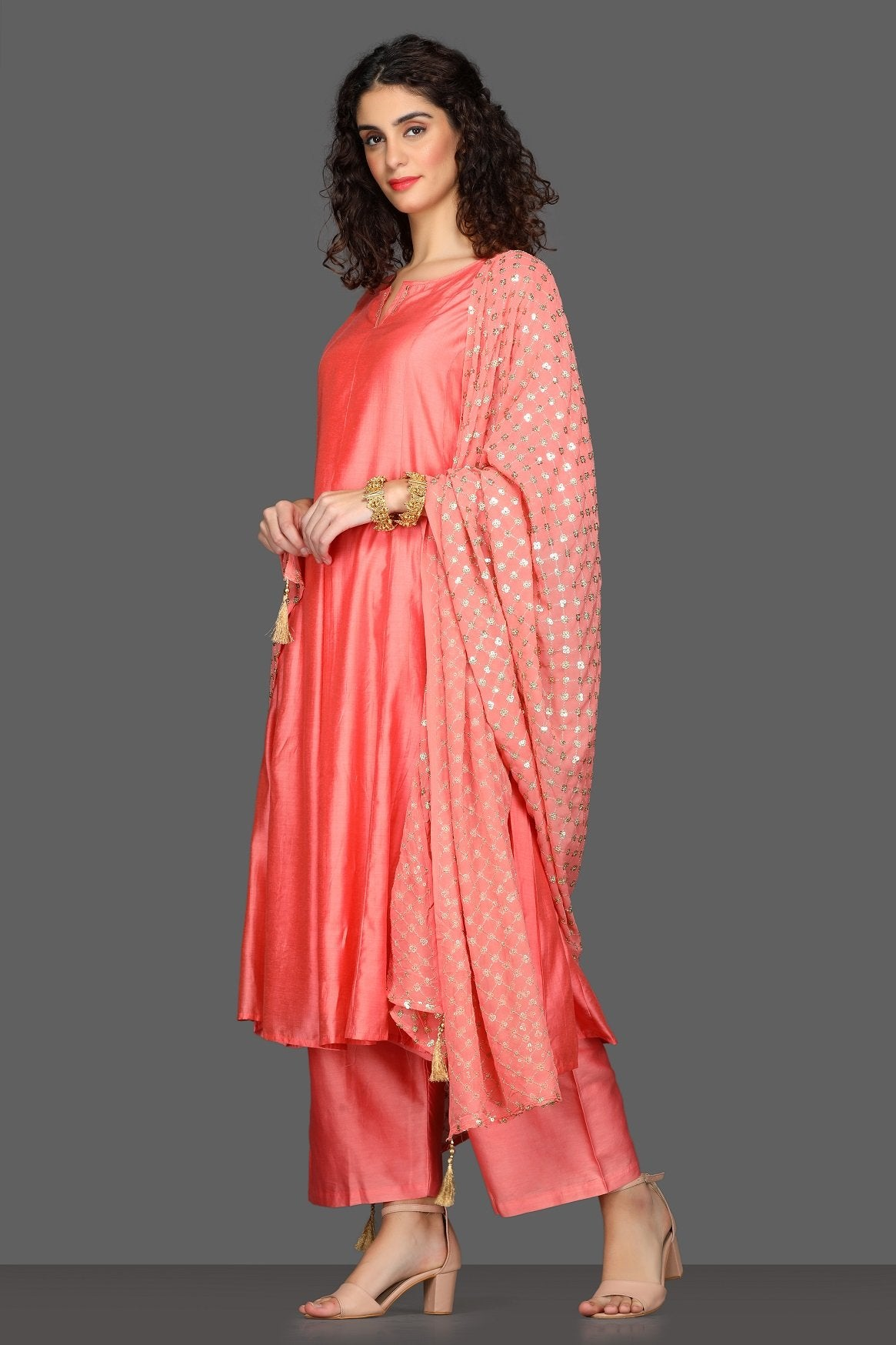 Shop gorgeous peach flared palazzo suit online in USA with embellished dupatta. Dazzle on weddings and special occasions with exquisite Indian designer dresses, sharara suits, Anarkali suits from Pure Elegance Indian fashion store in USA.-side