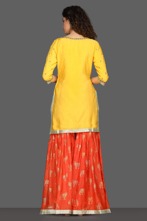 Buy bright yellow and red embroidered sharara suit online in USA with printed dupatta. Dazzle on weddings and special occasions with exquisite Indian designer dresses, sharara suits, Anarkali suits from Pure Elegance Indian fashion store in USA.-back