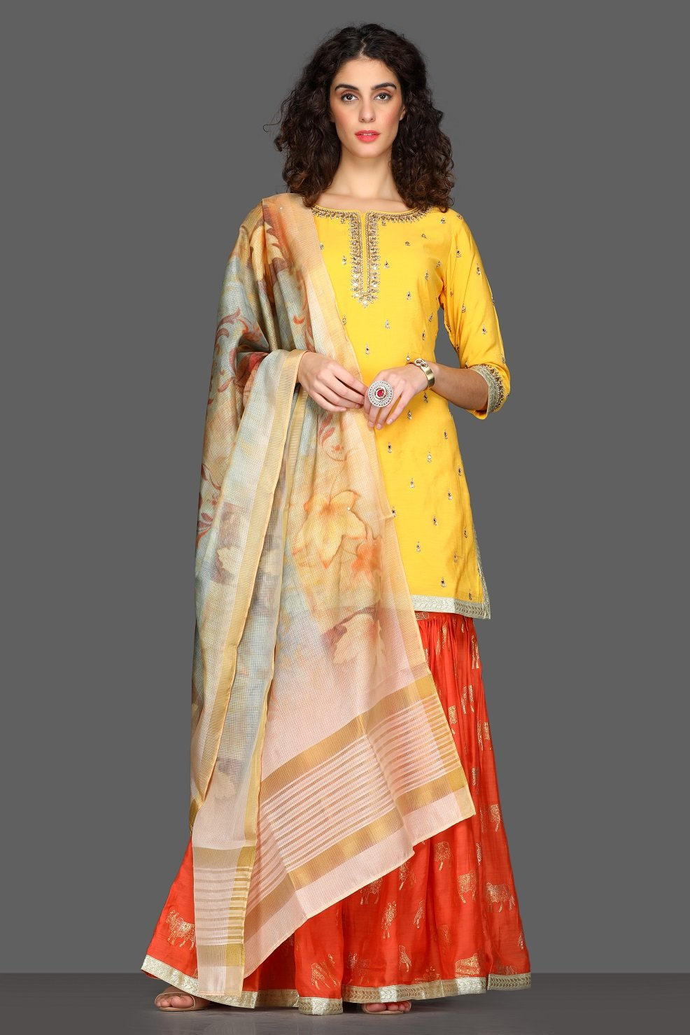 Buy bright yellow and red embroidered sharara suit online in USA with printed dupatta. Dazzle on weddings and special occasions with exquisite Indian designer dresses, sharara suits, Anarkali suits from Pure Elegance Indian fashion store in USA.-full view