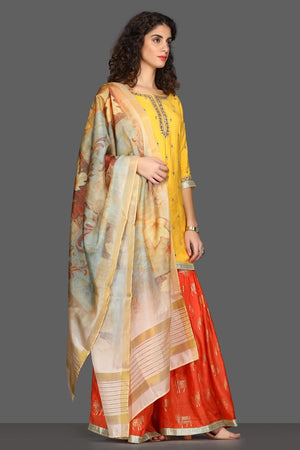 Buy bright yellow and red embroidered sharara suit online in USA with printed dupatta. Dazzle on weddings and special occasions with exquisite Indian designer dresses, sharara suits, Anarkali suits from Pure Elegance Indian fashion store in USA.-side