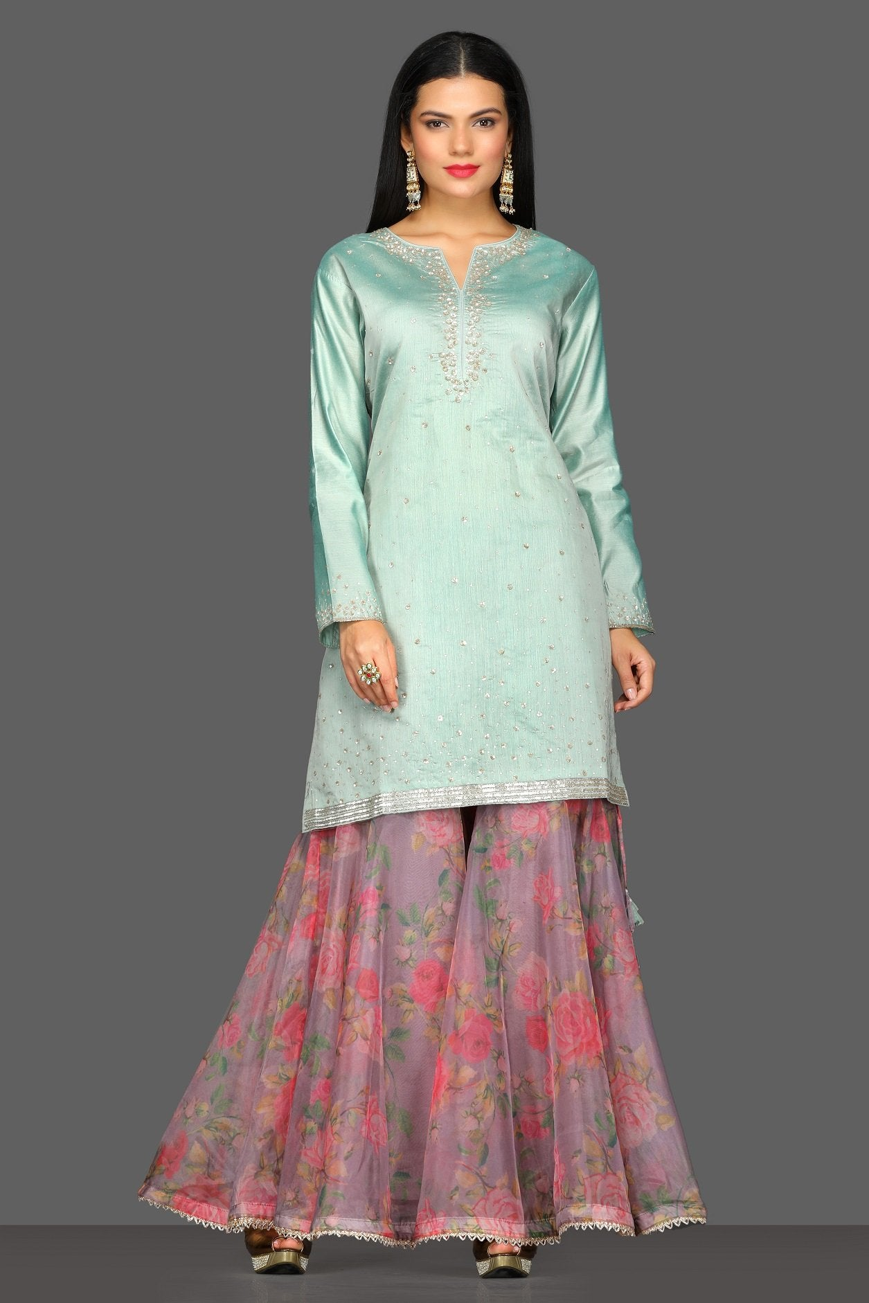 Shop beautiful mint green and floral pink embroidered sharara suit online in USA. Dazzle on weddings and special occasions with exquisite Indian designer dresses, sharara suits, Anarkali suits from Pure Elegance Indian fashion store in USA.-front
