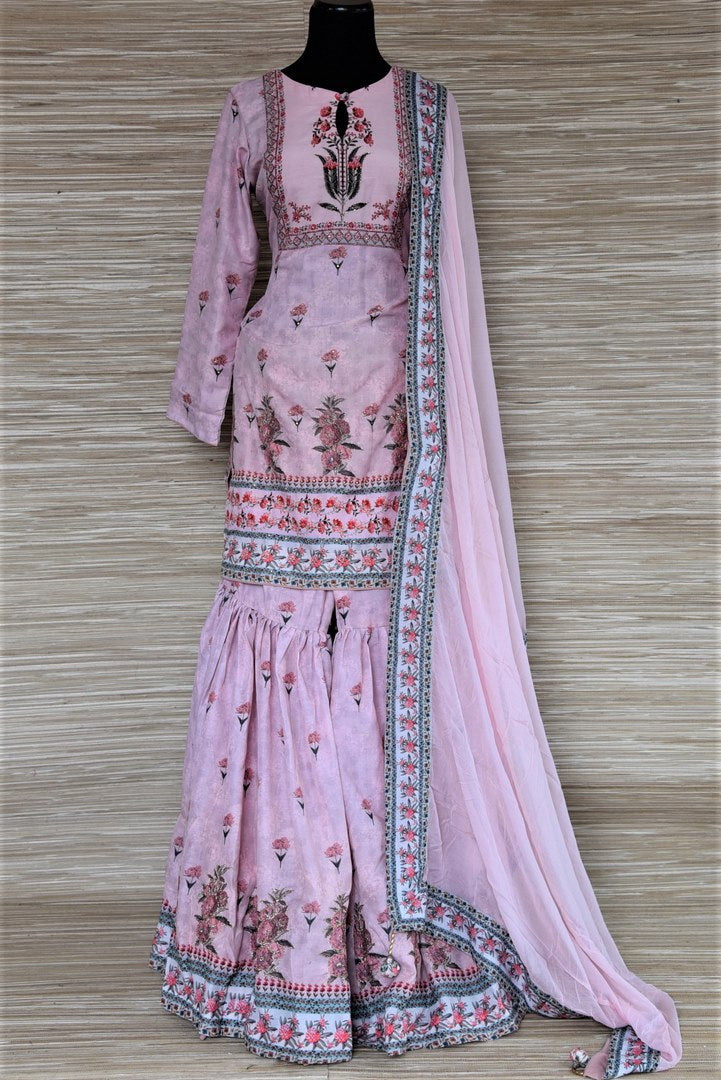 Buy stunning powder pink floral embroidered silk sharara suit online in USA with dupatta. Choose from a splendid variety of sharara suits, Anarkali suits, designer lehenga for weddings and festive occasions from Pure Elegance Indian clothing store in USA.-full view