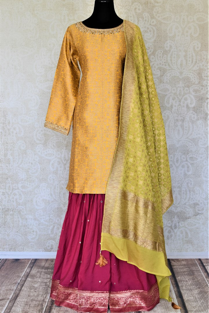 Buy gorgeous yellow and pink embroidered silk sharara suit online in USA with green dupatta. Elevate your ethnic style on weddings and festive occasions with stunning designer Anarkali suits, sharara suits, palazzo suits, salwar suits from Pure Elegance Indian fashion boutique in USA.-full view