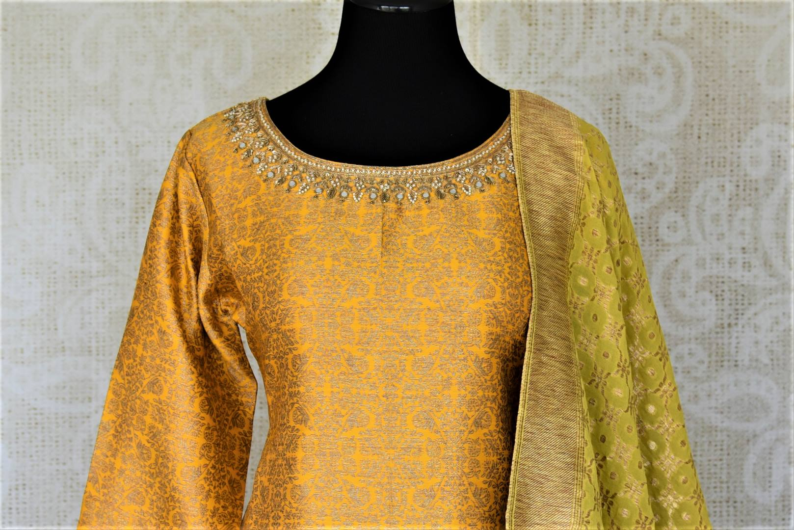 Buy gorgeous yellow and pink embroidered silk sharara suit online in USA with green dupatta. Elevate your ethnic style on weddings and festive occasions with stunning designer Anarkali suits, sharara suits, palazzo suits, salwar suits from Pure Elegance Indian fashion boutique in USA.-front