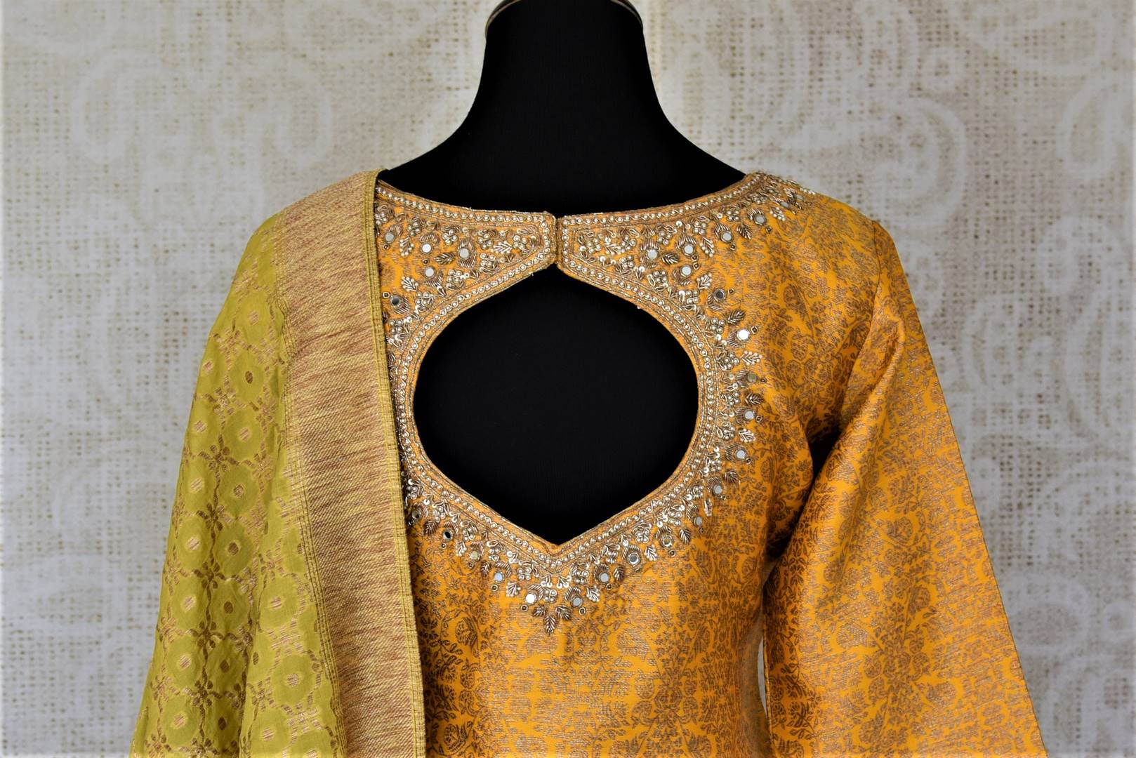 Buy gorgeous yellow and pink embroidered silk sharara suit online in USA with green dupatta. Elevate your ethnic style on weddings and festive occasions with stunning designer Anarkali suits, sharara suits, palazzo suits, salwar suits from Pure Elegance Indian fashion boutique in USA.-back