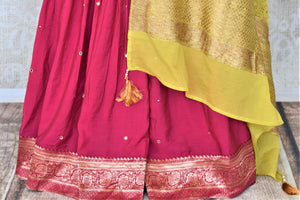 Buy gorgeous yellow and pink embroidered silk sharara suit online in USA with green dupatta. Elevate your ethnic style on weddings and festive occasions with stunning designer Anarkali suits, sharara suits, palazzo suits, salwar suits from Pure Elegance Indian fashion boutique in USA.-palazzo