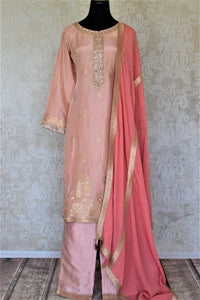Shop elegant dusty pink embroidered silk palazzo suit online in USA with dupatta. Elevate your ethnic style on weddings and festive occasions with stunning designer Anarkali suits, sharara suits, palazzo suits, salwar suits from Pure Elegance Indian fashion boutique in USA.-full view