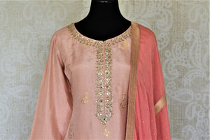 Shop elegant dusty pink embroidered silk palazzo suit online in USA with dupatta. Elevate your ethnic style on weddings and festive occasions with stunning designer Anarkali suits, sharara suits, palazzo suits, salwar suits from Pure Elegance Indian fashion boutique in USA.-front