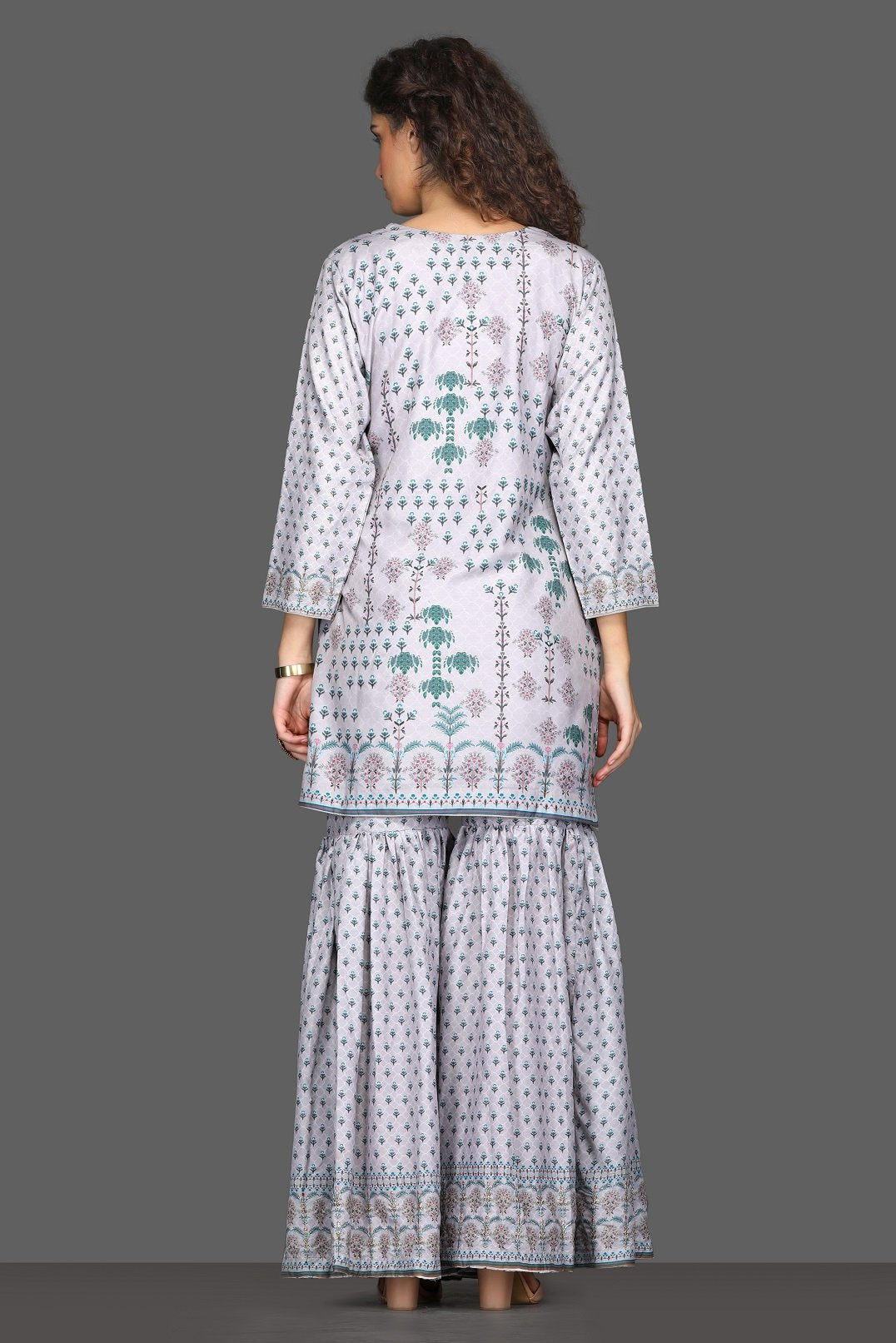 Shop beautiful lilac printed garara suit online in USA with dupatta. Dazzle on weddings and special occasions with exquisite Indian designer dresses, sharara suits, Anarkali suits from Pure Elegance Indian fashion store in USA.-back