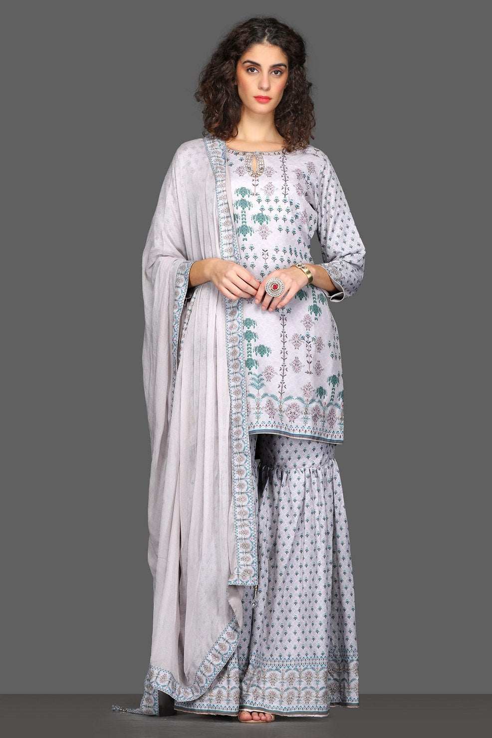 Shop beautiful lilac printed garara suit online in USA with dupatta. Dazzle on weddings and special occasions with exquisite Indian designer dresses, sharara suits, Anarkali suits from Pure Elegance Indian fashion store in USA.-full view