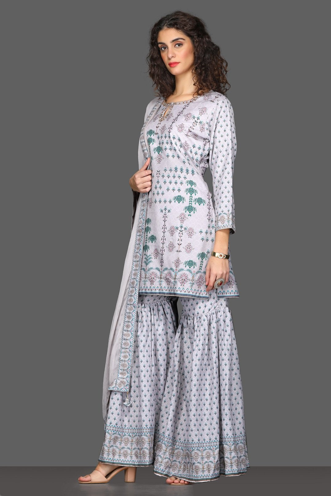 Shop beautiful lilac printed garara suit online in USA with dupatta. Dazzle on weddings and special occasions with exquisite Indian designer dresses, sharara suits, Anarkali suits from Pure Elegance Indian fashion store in USA.-side