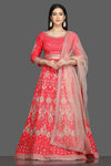Buy stunning tomato red embroidered designer lehenga online in USA with net dupatta. Flaunt your sartorial choices on special occasions with beautiful designer gowns, Anarkali suits, traditional salwar suits, Indian lehengas from Pure Elegance Indian fashion boutique in USA. -full view
