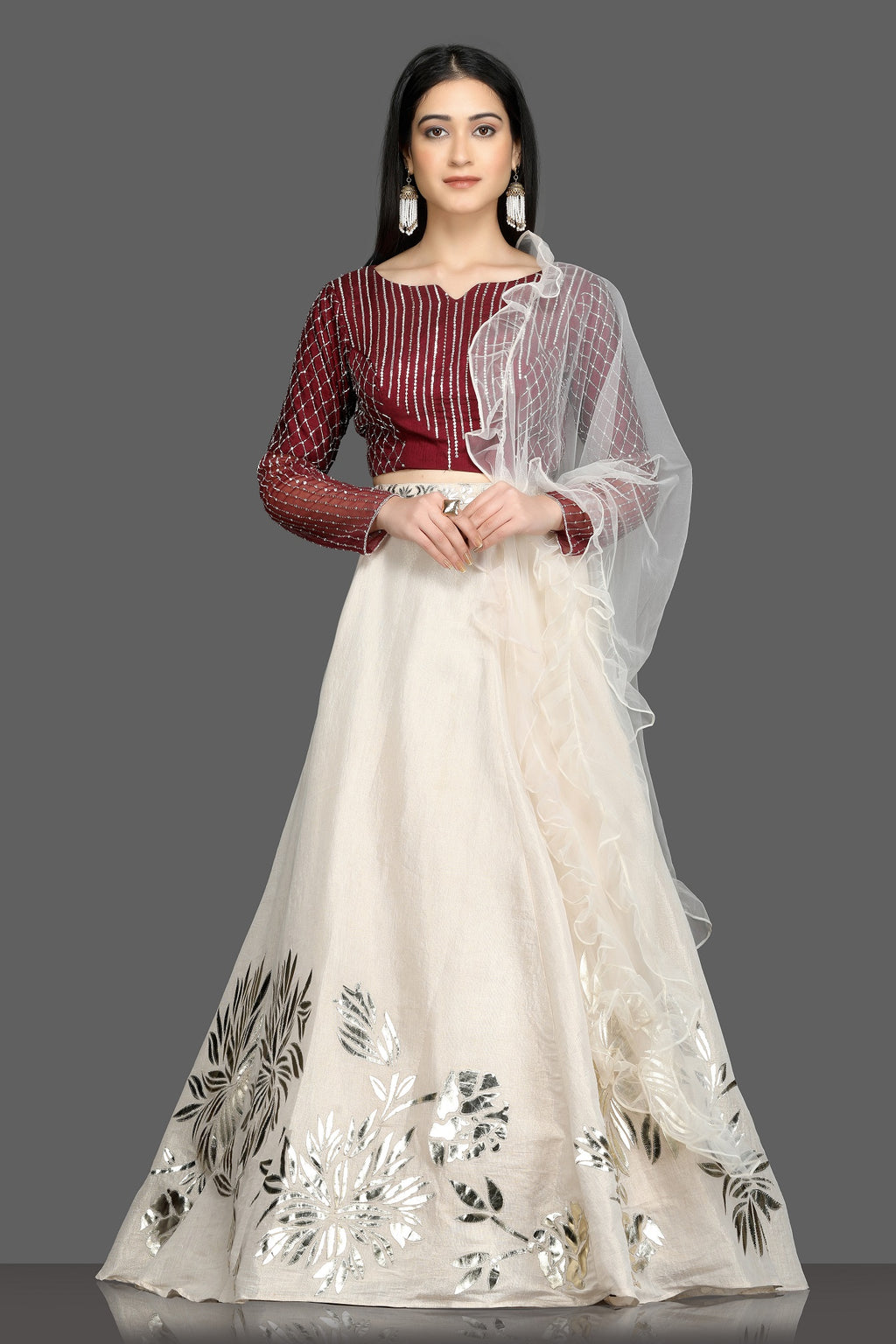 Buy gorgeous wine and cream applique work lehenga online in USA with ruffle dupatta. Flaunt your sartorial choices on special occasions with beautiful designer gowns, Anarkali suits, traditional salwar suits, Indian lehengas from Pure Elegance Indian fashion boutique in USA. -full view