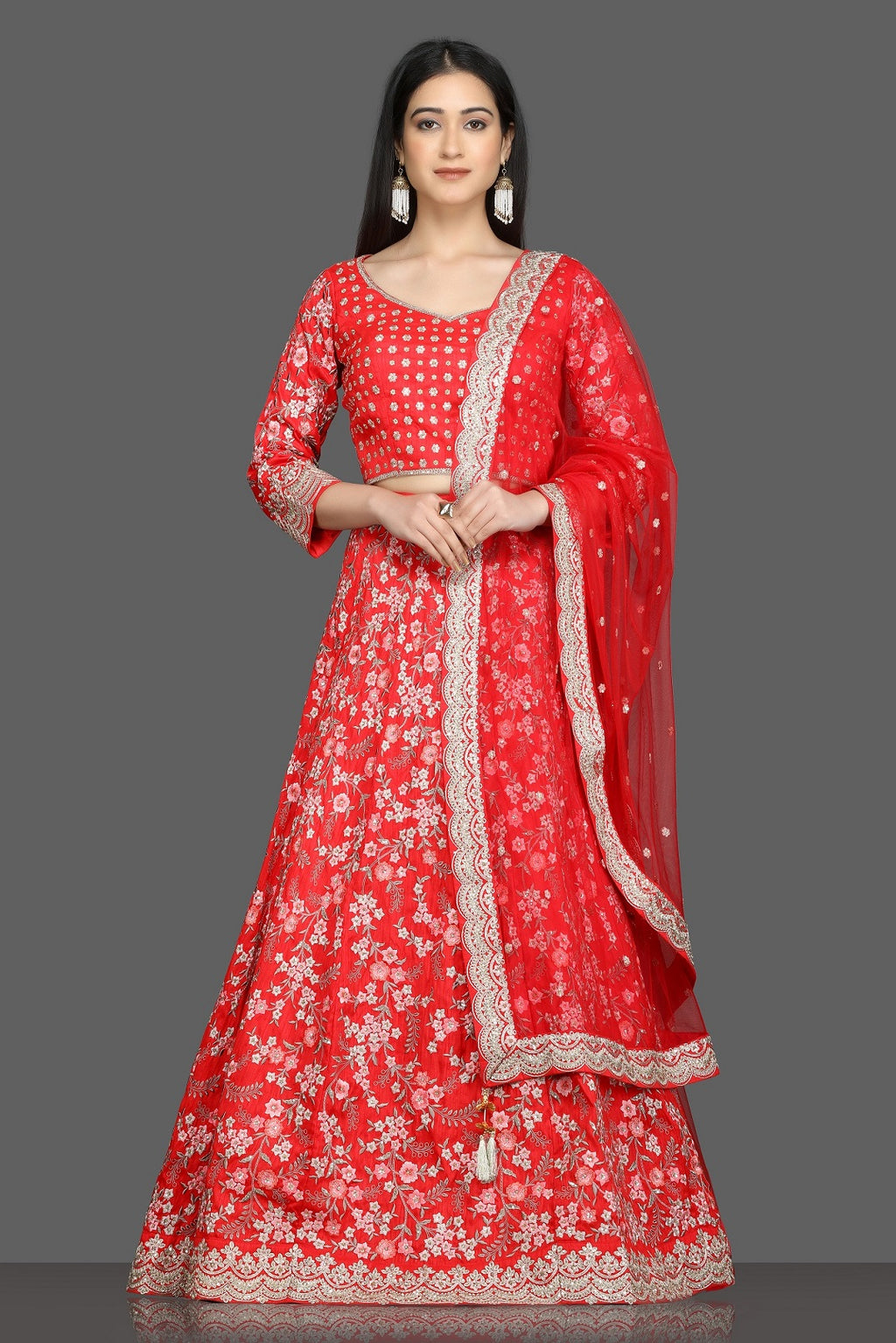 Shop beautiful tomato red embroidered lehenga online in USA with net dupatta. Flaunt your sartorial choices on special occasions with beautiful designer gowns, Anarkali suits, traditional salwar suits, Indian lehengas from Pure Elegance Indian fashion boutique in USA. -full view