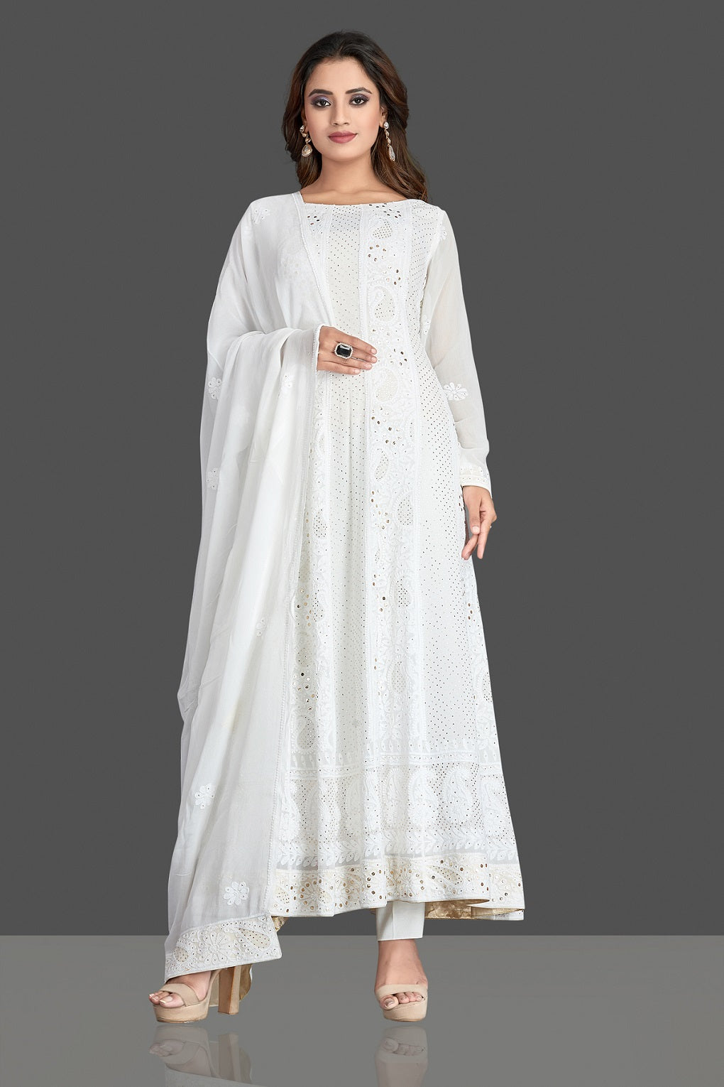 Buy stunning white georgette Lucknowi chikankari Anarkali suit online in USA. Flaunt your sartorial choice with beautiful embroidered Anarkali, sharara suits, designer lehengas, designer gowns from Pure Elegance Indian saree store in USA.-front