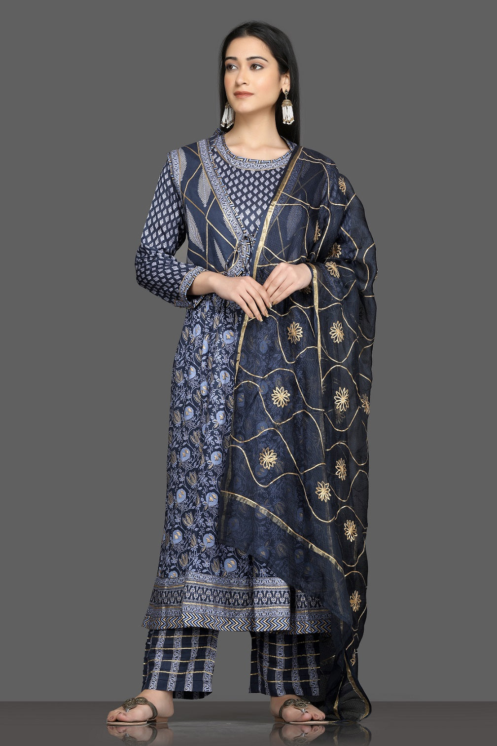 Shop beautiful blue printed silk suit online in USA with waist coat and dupatta. Shop for parties and festive occasions stunning designer suits, Anarkali suits, designer gowns, wedding lehengas from Pure Elegance Indian fashion store in USA.-full view