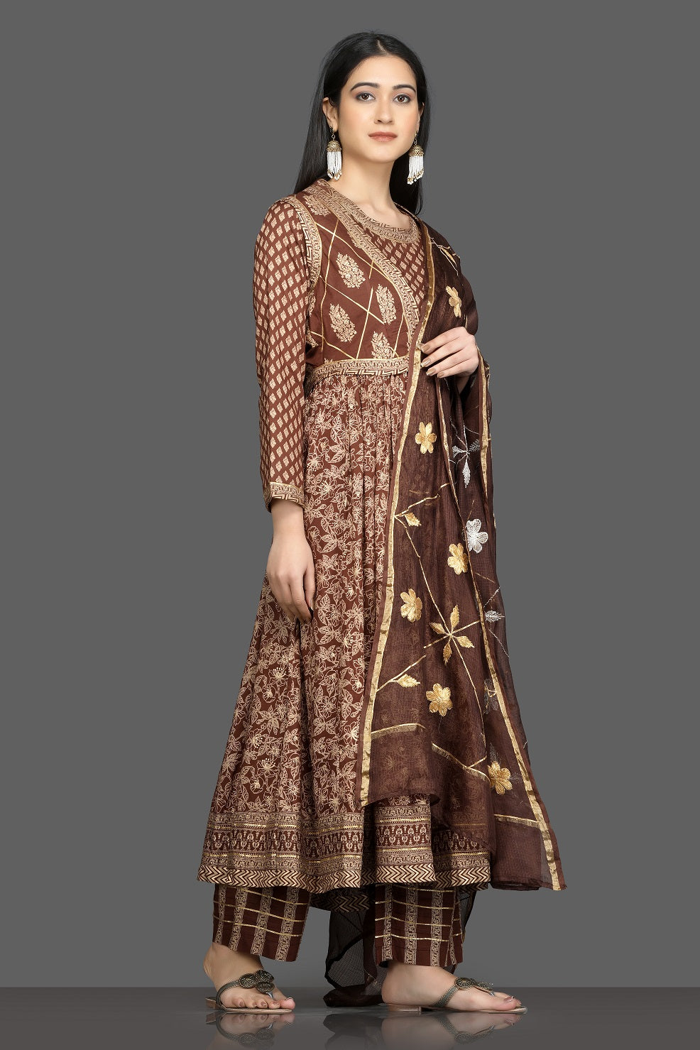 Buy beautiful brown printed silk Anarkali suit online in USA with waist jacket and dupatta. Shop for parties and festive occasions stunning designer suits, Anarkali suits, designer gowns, wedding lehengas from Pure Elegance Indian fashion store in USA.-side