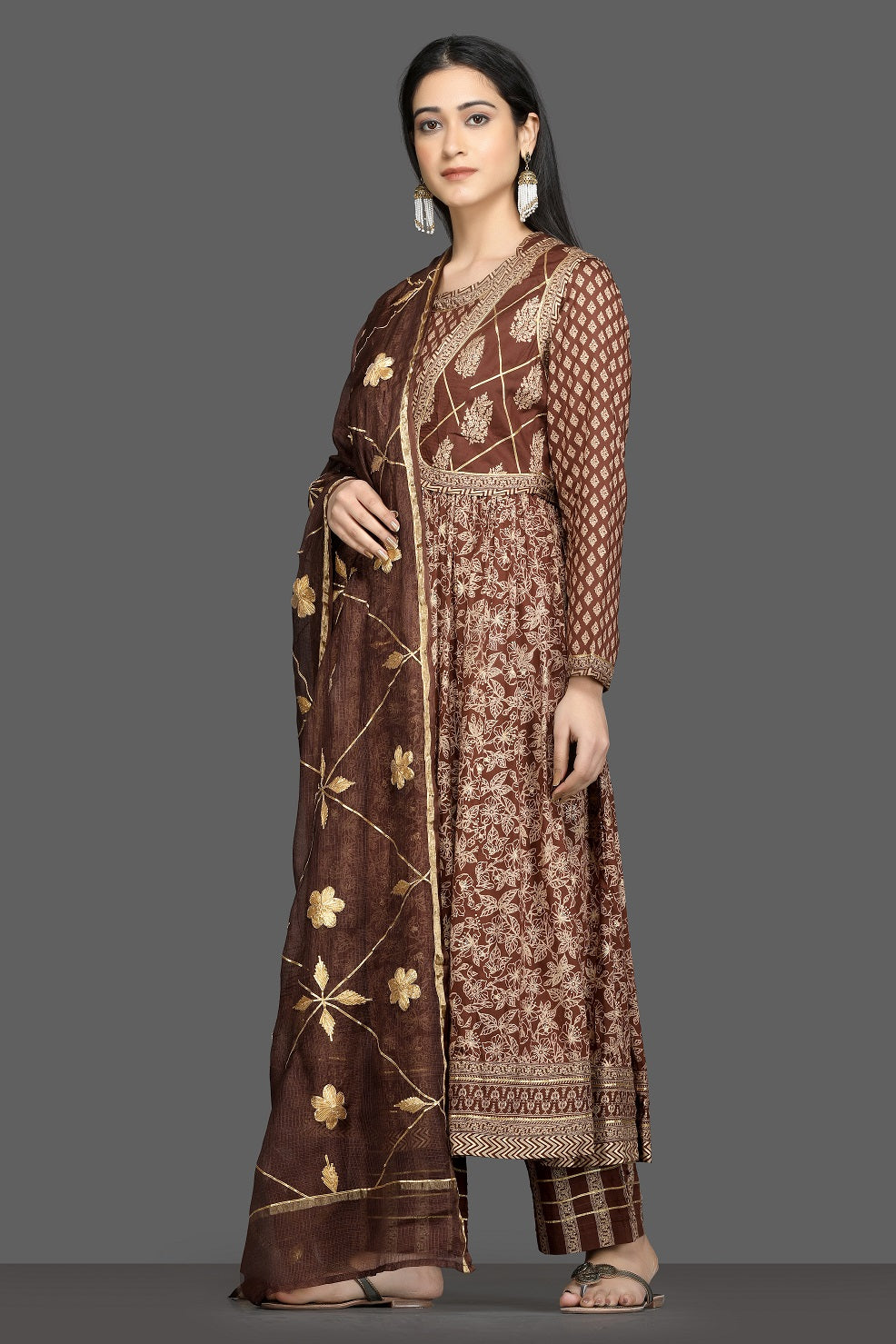Buy beautiful brown printed silk Anarkali suit online in USA with waist jacket and dupatta. Shop for parties and festive occasions stunning designer suits, Anarkali suits, designer gowns, wedding lehengas from Pure Elegance Indian fashion store in USA.-left